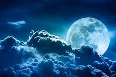 Super moon. Nighttime sky with clouds and bright full moon with stock photography