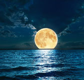 Super moon over water Royalty Free Stock Photo