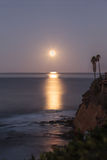 Super moon sets over the Pacific ocean Stock Photo