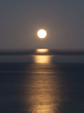 Super moon sets over the Pacific ocean Stock Photography