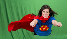 Super Mother Role Model Hero Flying Green Screen. Beautiful woman plays super mom flying on green screen Royalty Free Stock Photo