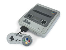 Super Nintendo game console. Retro Super Nintendo game console isolated on white Royalty Free Stock Photos