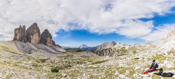 Free Super Panorama Of The Mountain Ridge Of Tre Cime Di Lavaredo And Resting Tourist With His Dog Stock Photography - 211938132