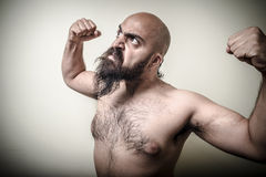 Super power angry muscle bearded man Royalty Free Stock Photo