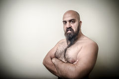 Super power angry muscle bearded man Royalty Free Stock Photos