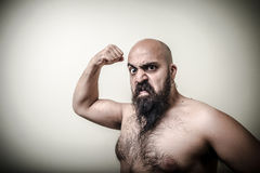 Super power angry muscle bearded man Stock Image