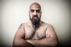 Super power angry muscle bearded man. On gray background Royalty Free Stock Photo