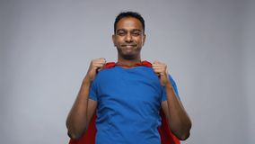 Indian man in superhero cape showing thumbs up stock footage