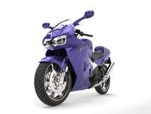 Super purple sports motor bike - front wheel closeup shot Royalty Free Stock Images