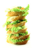 Super pyramid. Super size fresh sandwich with lot of iceberg lettuce and salmon on top Stock Images