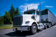 Super rig semi truck day cab bulk trailer on road Stock Photos