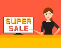 Super sale. girl points at a computer screen, . Stock Photos