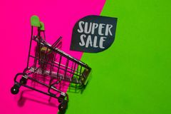 Super Sale Text and Shopping cart. Discount and promotion business concept on colorful background royalty free stock photography