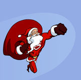Super Santa. Flying forward with the huge bag of presents Royalty Free Stock Photos