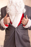 Super Santa. Opens A Tuxedo And Shows he Santa Clothes Stock Image