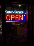 Super Service Sign @ Japan. A sign saying super-service OPEN in Kyoto, Japan Royalty Free Stock Photo