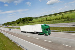 Super sized truck in motion Royalty Free Stock Photo
