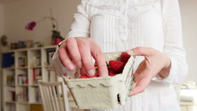 Super slow motion close-up shot of woman eating organic strawberry stock video