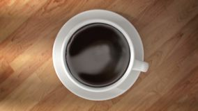Super slow motion drops of coffee are falling into cup