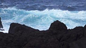 Super slow motion of ocean near volcanic rocks stock video