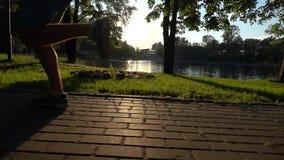 Super slow motion steadicam clip of sunset park and runner leaving frame stock video