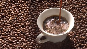 Super slow motion top view of coffee pour into cup from geyser coffee maker stock video