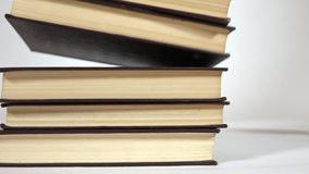 Super slow motion video of falling books stock video footage