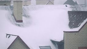 Super slow motion video of snowstorm above residential houses in winter. Super slow motion shot of snowstorm above residential houses in winter stock video footage
