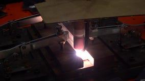 Super slow video apprentice metal worker welding in factory