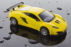 Super Sports Car. Yellow Super Sports Car isolated over water drops background Stock Photography