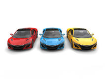Super sports cars in primary colors. Isolated on white background Stock Images