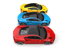 Super sports cars in primary colors - top down view Royalty Free Stock Photo