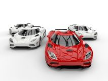Super sports cars racing - closeup focus on the red car Royalty Free Stock Images