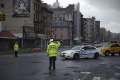 After super storm Sandy in new york. Police officers directing traffic in lower manhattan street after super storm Sandy Stock Images