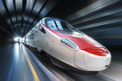 Super streamlined train. In motion Royalty Free Stock Photography