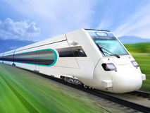 Super streamlined train on rail. Super streamlined train with motion blur moves on countryside Royalty Free Stock Images