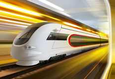 Super streamlined train in tunnel. Super streamlined train with motion blur moves in tunnel Stock Photo