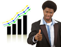 Super Success!. This is an image of a businessman giving thumbs up, due to the rise in the graph Stock Photo