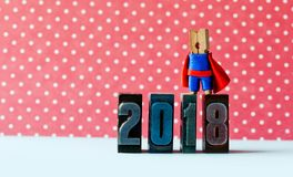 Super successful 2018 new year card. Brave superhero leader posing on vintage letterpress digits. Beautiful clothespin. Metaphor character in red blue costume Royalty Free Stock Photos