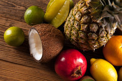 Super tasty tropical fruits on wooden table Stock Photos