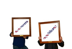 Super Tuesday. Tho mans holding picture frames with the inscription democrats-republicans stock images