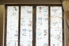 Super typhoon Mangkhut heads for China and the glass windows being reinforceed by wet newspaper Stock Photography