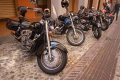 Super vintage motorcycles bikes and sports cars royalty free stock photo