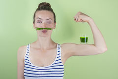 Super wheat grass power!. Fit and strong with wheat grass juice Royalty Free Stock Photos