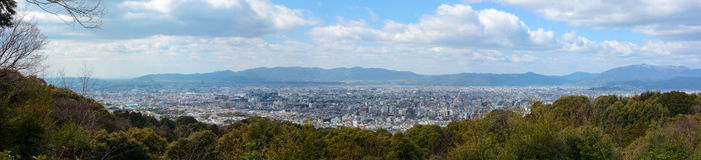 Super wide panorama of Kyoto city in Japan and the surrounding landscape and mountains Stock Images