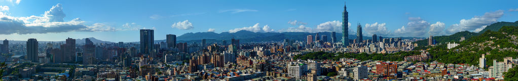 Super wide panorama of the modern city of Taipei, the capital of Taiwan. Very wide panorama of the modern capital city of Taipei, Taiwan and the surrounding stock image