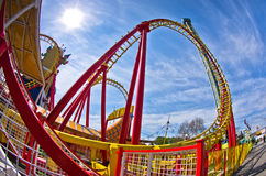 Super wide view of a colorful roller coaster in Prater amusement park at Vienna Royalty Free Stock Photography