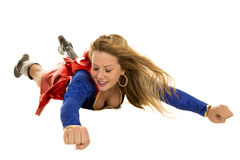 Super woman flying fists eyes closed royalty free stock images