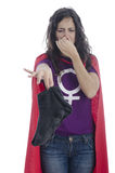 Super woman hero holding her nose against a bad smell Royalty Free Stock Image