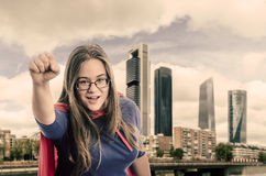 Super woman hero with red cape and mask in Madrid. Vintage color Stock Photo